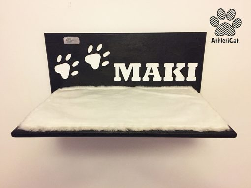 Wooden cat shelf with carved writing