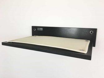 black cat shelf with beige fabric