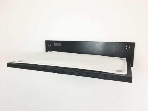 black cat shelf with white fabric