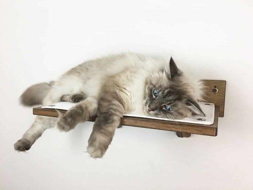 walnut cat shelf with white fabric